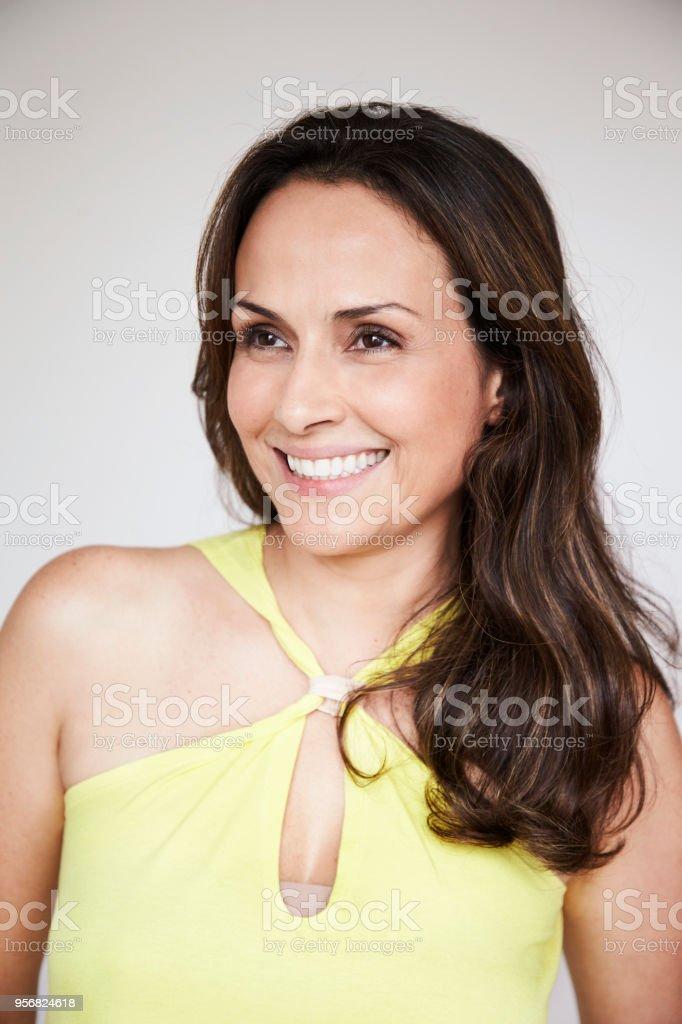 Happy brunette smiling stock photo
