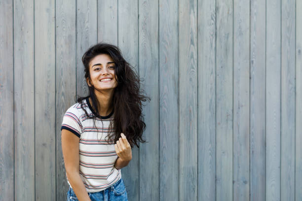 Happy brunette woman looking at camera, outdoors portrait Happy brunette woman looking at camera, outdoors portrait armenian ethnicity stock pictures, royalty-free photos & images