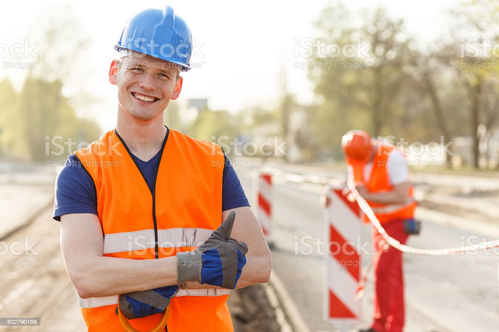 Happy builder in helmet stock photo