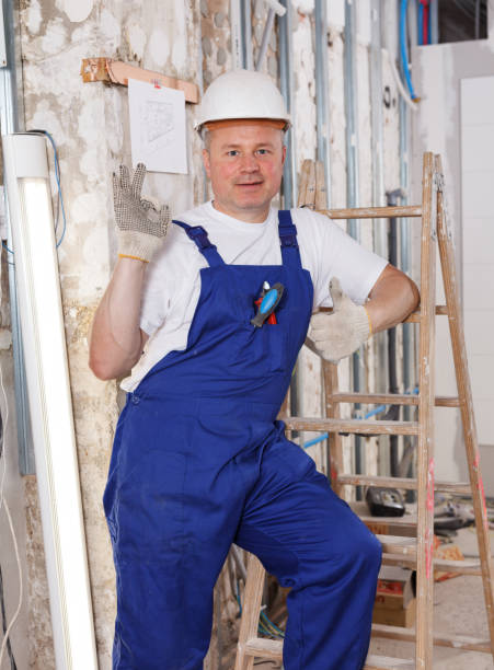 Happy builder Happy confident professional builder posing in repairable room approbation stock pictures, royalty-free photos & images