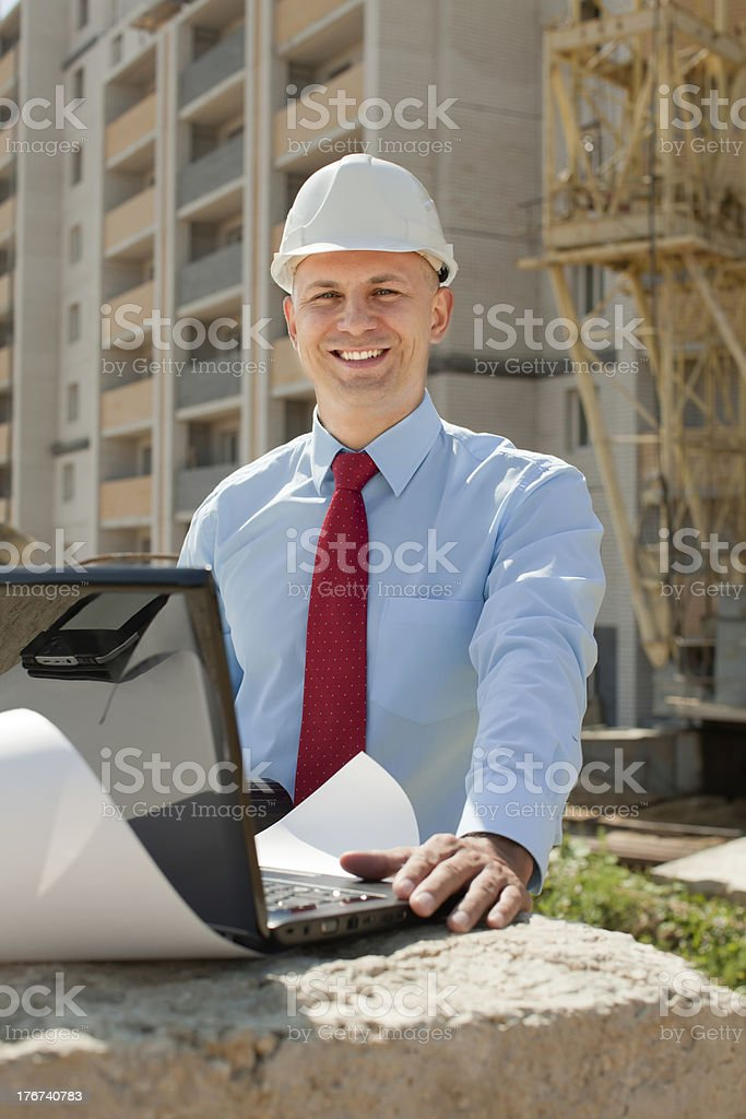 Happy builder works on the building site royalty-free stock photo