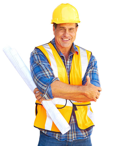 Happy Building Contractor At Construction Site stock photo