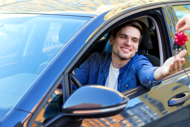 Happy buisnessman bought a new car as gift stock photo