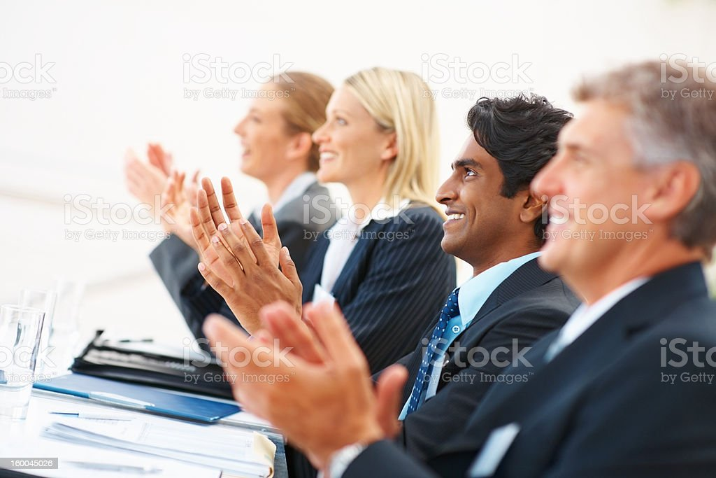 Happy business colleagues clapping in office royalty-free stock photo