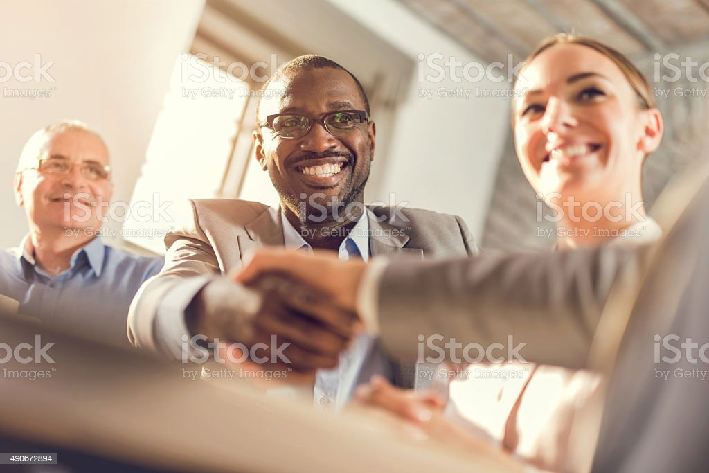 Happy business colleagues come to an agreement in the office. stock photo