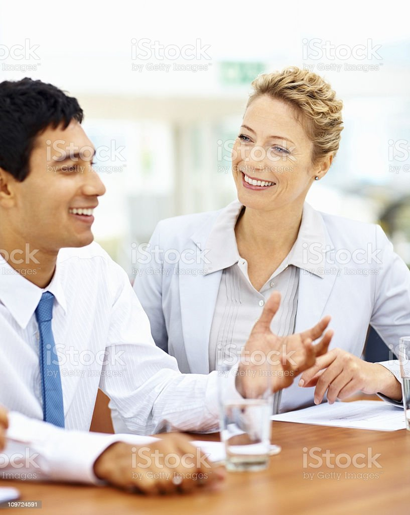Happy business colleagues discussing in office royalty-free stock photo