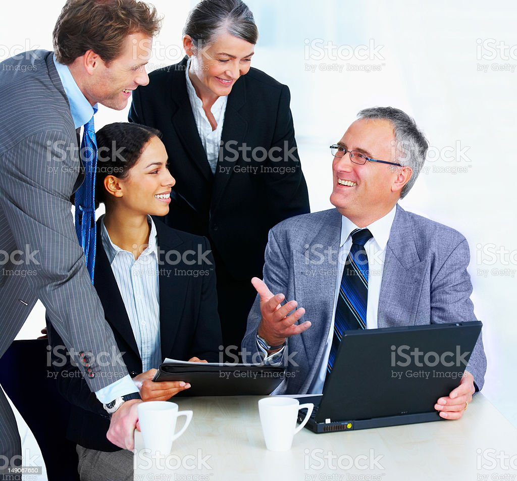 Happy business colleagues during a meeting in office royalty-free stock photo