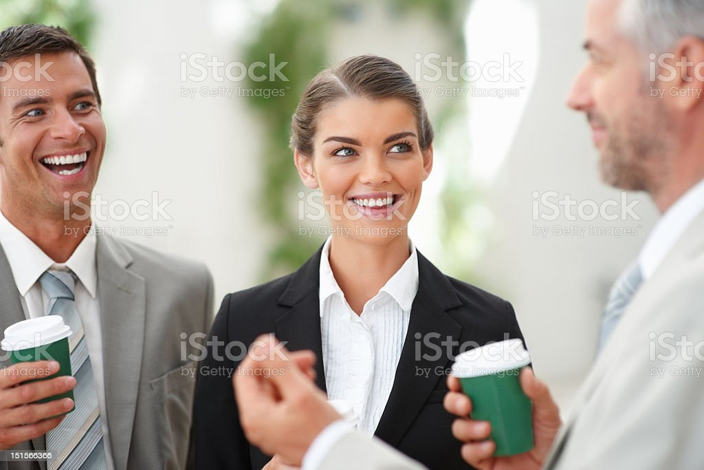 Happy business colleagues holding coffee shaker in break royalty-free stock photo