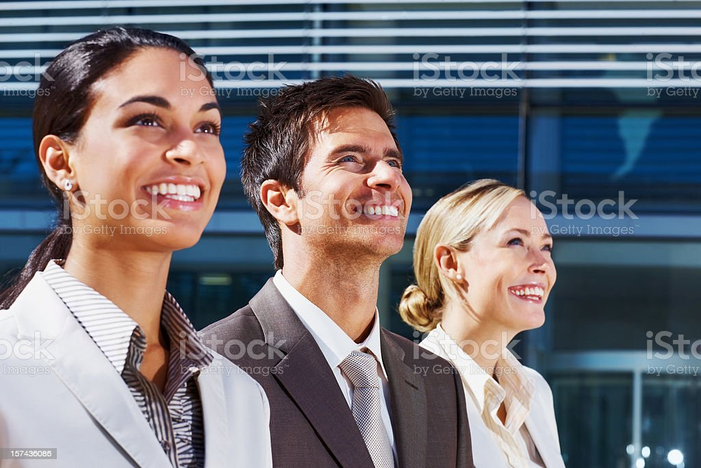 Happy business colleagues looking up royalty-free stock photo