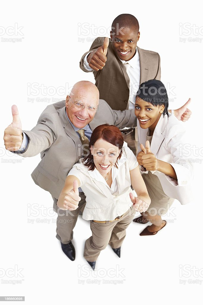 Happy business colleagues showing thumbs up against white royalty-free stock photo