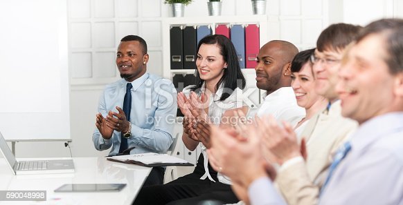 171328775 istock photo Happy business coworkers celebrating 590048998