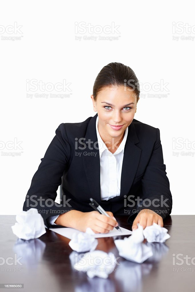 Happy business executive writing down ideas against white royalty-free stock photo