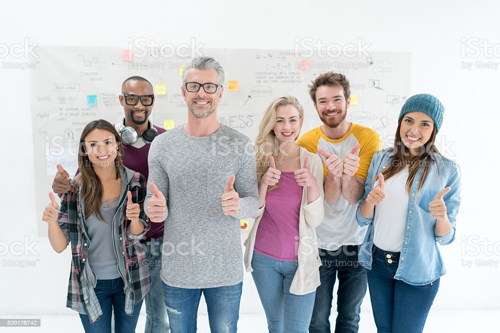 Happy business group with thumbs up stock photo