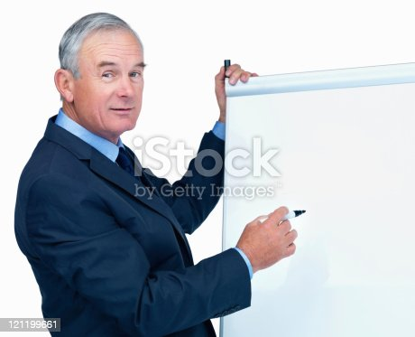 Senior business man giving a presentation using a flip chart , place your text