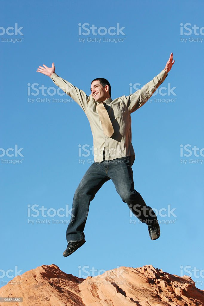 Happy business man jumping royalty-free stock photo