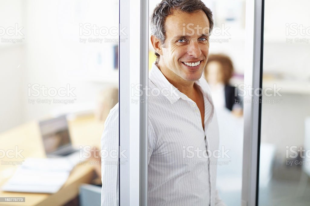 Happy business man standing in a glass door royalty-free stock photo