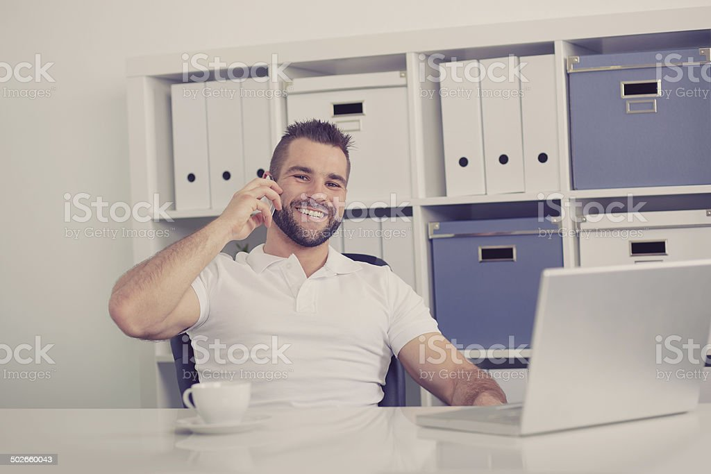 Happy business man talking on the phone, toned stock photo