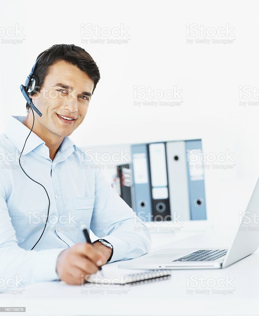 VOIP - Happy business man using a laptop and headset royalty-free stock photo