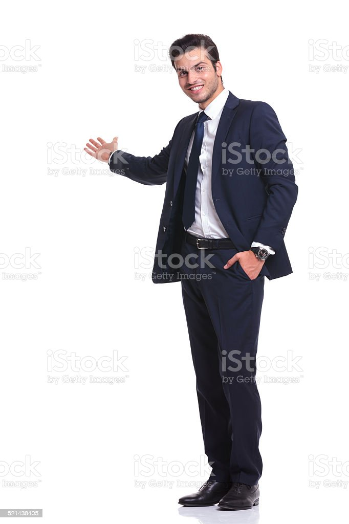 happy business man welcoming you stock photo