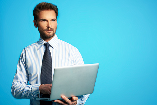 Happy Business Man With A Laptop Stock Photo - Download Image Now