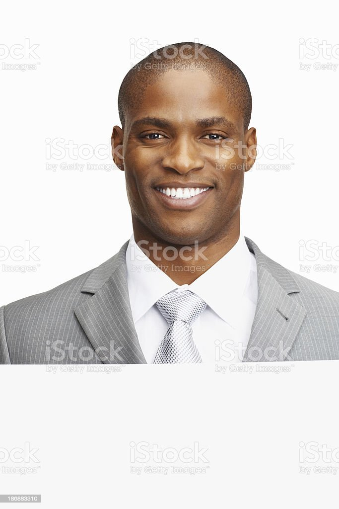 Happy business man with a sheet against white background royalty-free stock photo