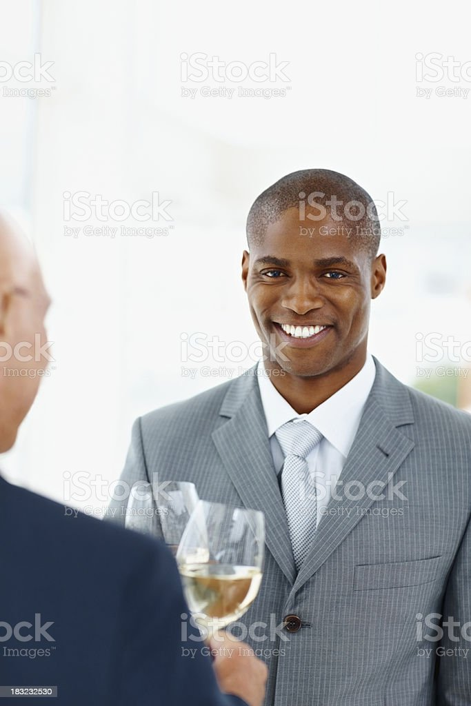 Happy business man with his colleague toasting champagne royalty-free stock photo
