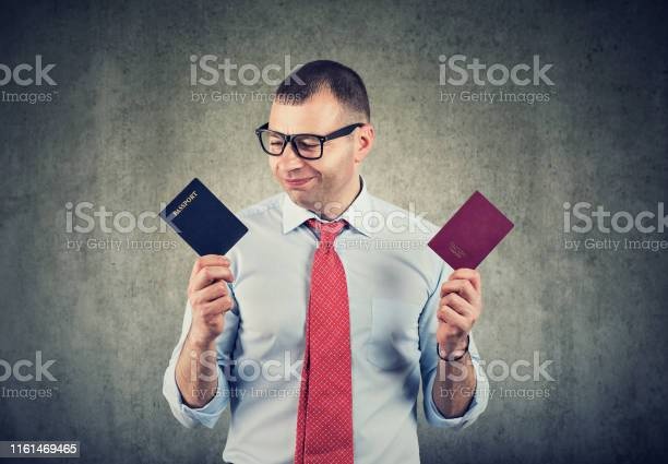 Happy business man with two passports dual citizenship picture id1161469465?b=1&k=6&m=1161469465&s=612x612&h=67zhoyptsk0srkcb0bo6kjuyeoyremd8enkgnjh8bao=