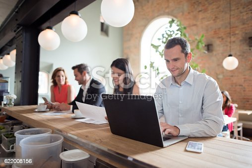 istock Happy business man working at a cafe 622008156