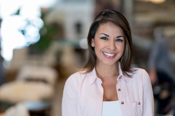 happy business owner at a restaurant - latina woman stock photos and pictures