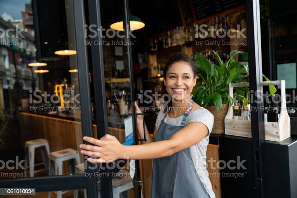 Happy business owner opening the door at a cafe picture id1061010034?b=1&k=6&m=1061010034&s=612x612&h=ykn8fygg4ywcq6yr2e77rxetc0jzytsbxdvtc4nc02c=