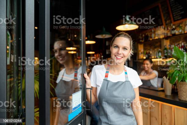 Happy business owner opening the door at a cafe picture id1061010244?b=1&k=6&m=1061010244&s=612x612&h=3xyxpwy708wmkd4taoyx3kocvqdbyzagd5lf8wzn ao=