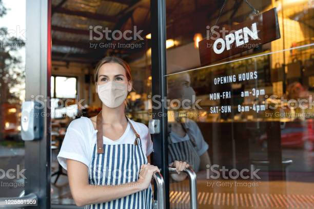 Happy business owner opening the door at a cafe wearing a facemask picture id1225861959?b=1&k=6&m=1225861959&s=612x612&h=2tp1egwrvhpps hratu3meisk7qwet ae4l31aztwhe=
