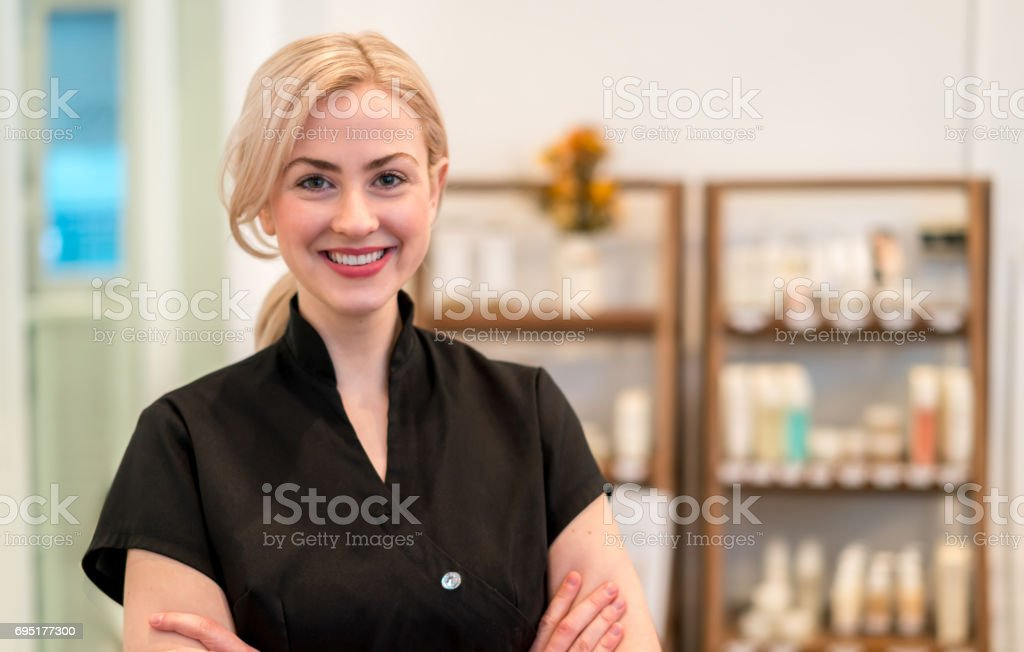 Happy business owner working at a spa stock photo