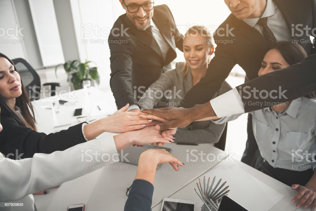Happy business partners creating union stock photo