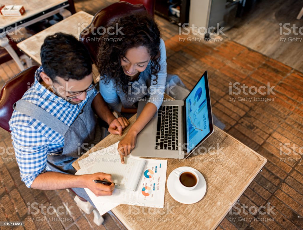 Happy business partners working together at a restaurant stock photo
