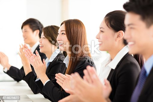 istock happy business people applauding in  conference 614625672