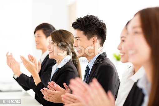 639200924 istock photo happy business people applauding in  conference 614990290