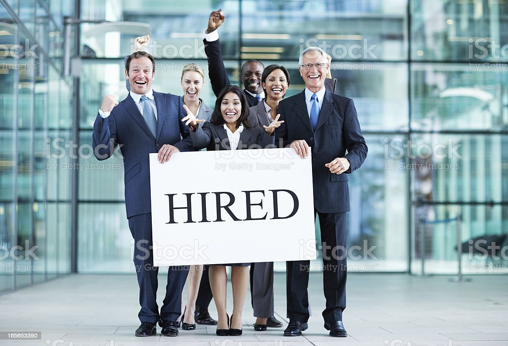 Happy business people being hired stock photo