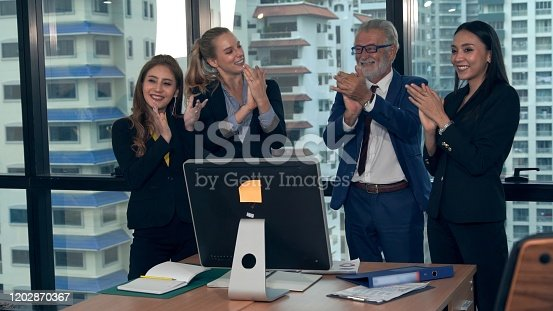 938516440 istock photo Happy business people celebrate victory of success 1202870367