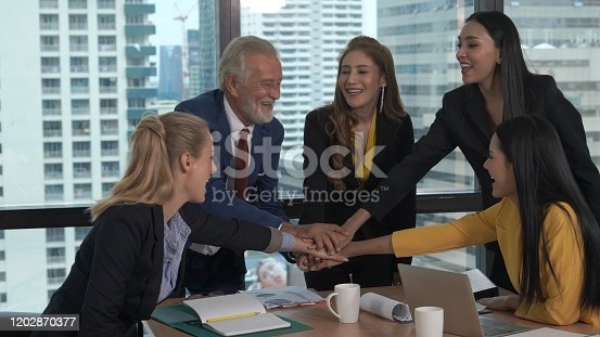 938516440 istock photo Happy business people celebrate victory of success 1202870377