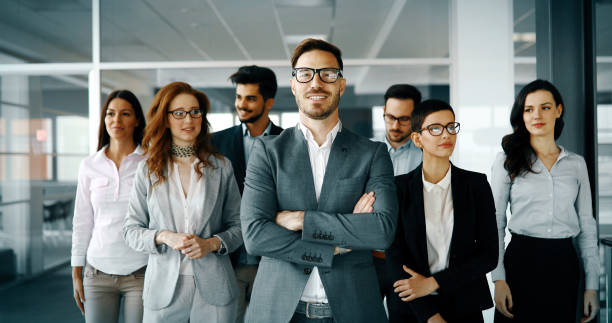 Happy business people celebrating success Happy business people celebrating success at company team work photos stock pictures, royalty-free photos & images