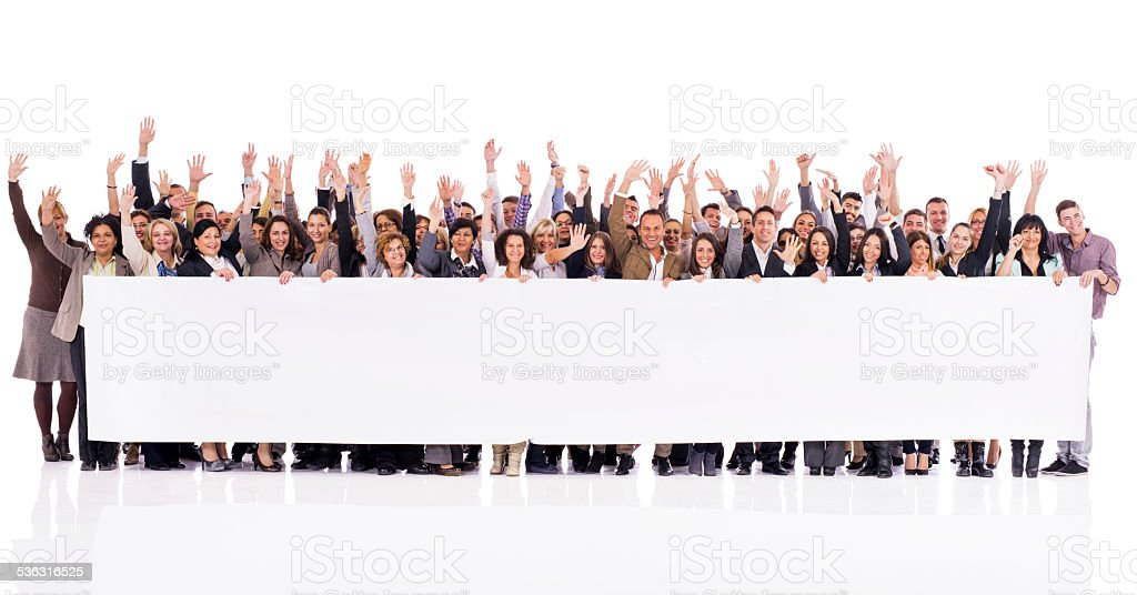 Happy business people holding banner. stock photo