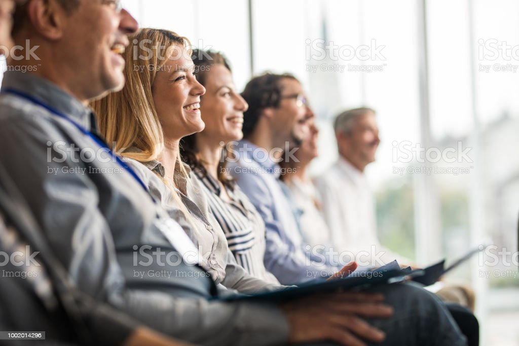 Happy business people in a line on a training class in the office. stock photo