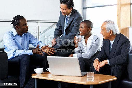 669854210 istock photo Happy business people sitting together in discussion 172379460