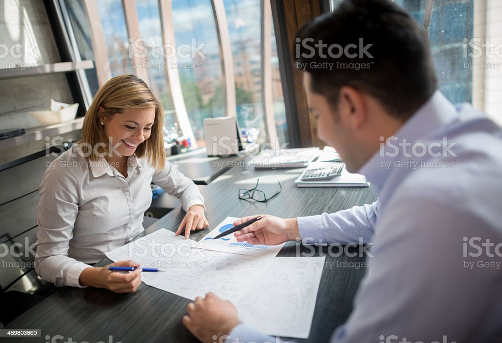 Happy business people working as a team stock photo