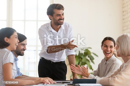 1141929391 istock photo Happy business team appreciating old female manager at group meeting 1182934049