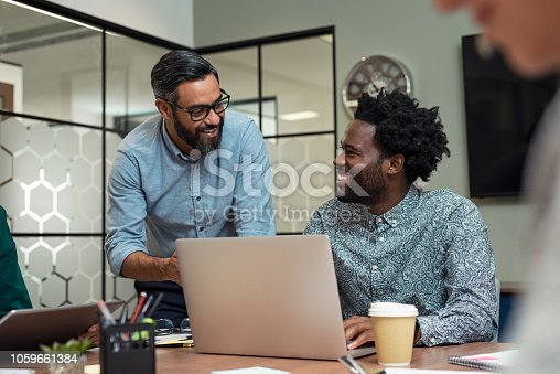 istock Happy business team in a meeting 1059661384