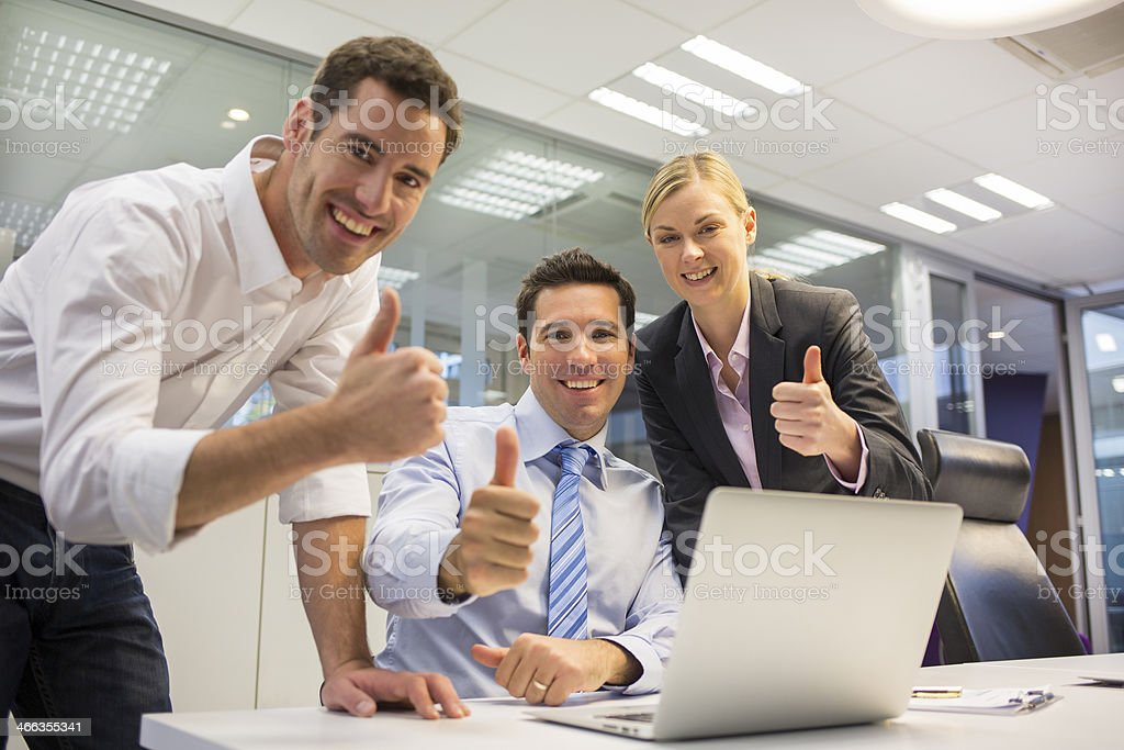 Happy business team in office celebrating a success royalty-free stock photo