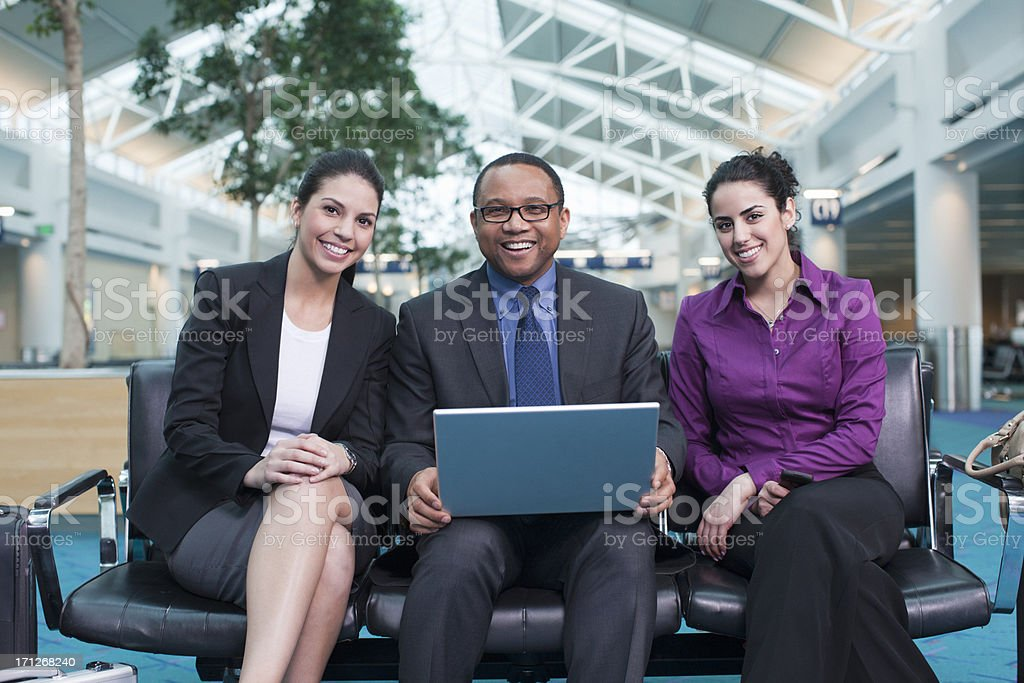 Happy Business Team Working at Airport stock photo