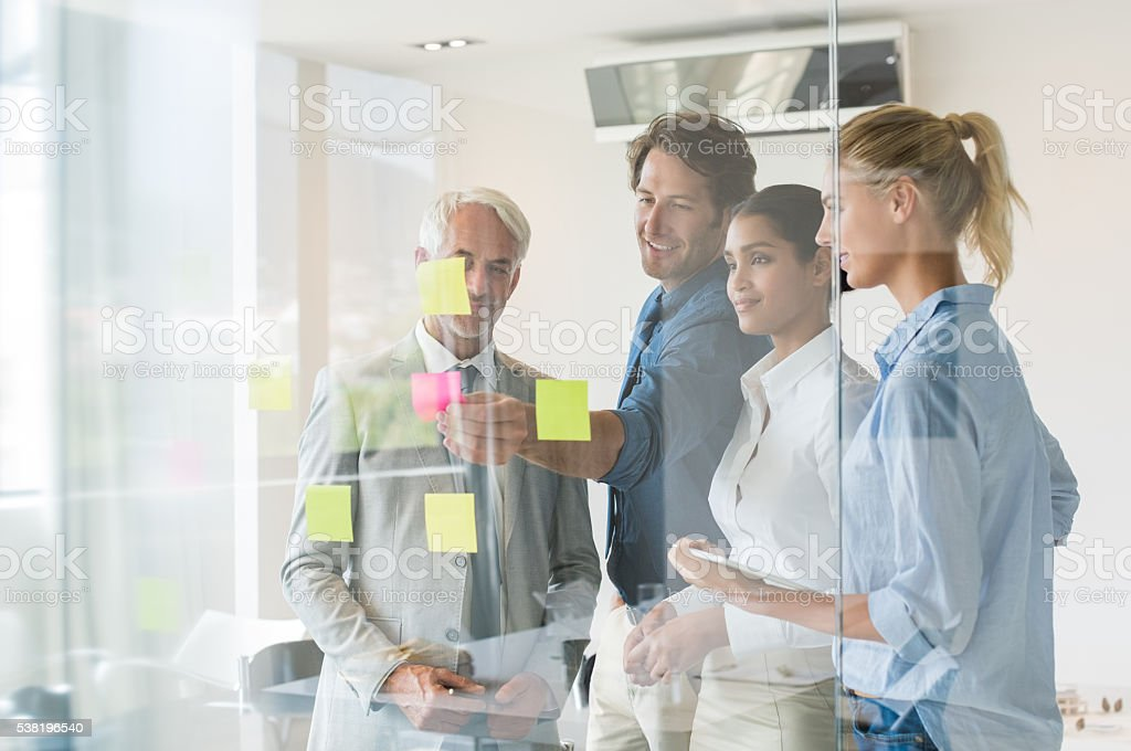 Happy business team working stock photo